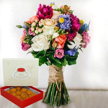 Mesmerizing Flowers and Motichoor Laddoo Combo: Anniversary Flowers & Sweets