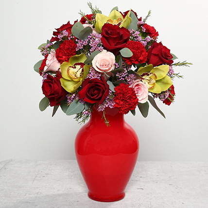 Mixed Flowers In Red Glass Vase: Christmas Flowers