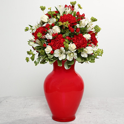 Red Carnations In Red Glass Vase: Gifts for Pisceans