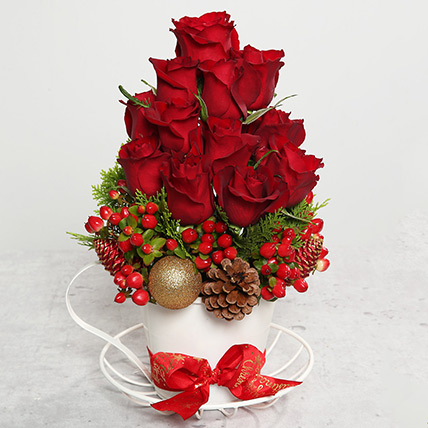 Red Roses and Berries Arrangement: Christmas Flowers to Al Ain