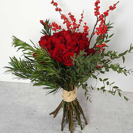 Red Roses and Ilex Berries Bouquet: Christmas Flowers to Ras Al Khaimah