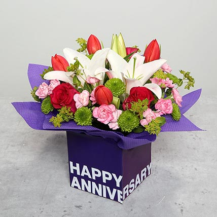 Tulips Roses and Carnations in Glass Vase: Anniversary Flowers to Ajman