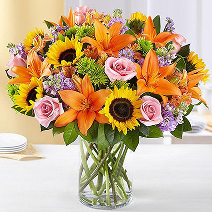 Vibrant Bunch of Flowers In Glass Vase:  Sunflower Bouquets