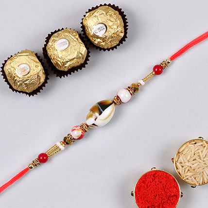 Designer Shell Rakhi And 3 Pcs Ferrero Rocher: Rakhi With Chocolates